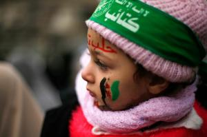 Palestinian girl attends with her mother a protest to show solidarity with trapped citizens of Aleppo, in Gaza