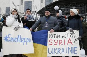 Participants attend a rally in solidarity with the people of Aleppo and against Russia's support of the Syrian army and President Bashar al-Assad in Kiev